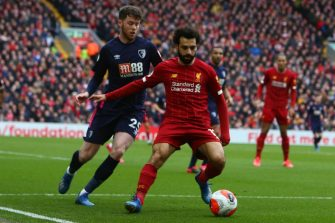 Liverpool's Egyptian midfielder Mohamed Salah (R) vies with Bournemouth's English defender Jack Simpson  during the English Premier League football match between Liverpool and Bournemouth at Anfield in Liverpool, north west England on March 7, 2020. (Photo by GEOFF CADDICK / AFP) / RESTRICTED TO EDITORIAL USE. No use with unauthorized audio, video, data, fixture lists, club/league logos or 'live' services. Online in-match use limited to 120 images. An additional 40 images may be used in extra time. No video emulation. Social media in-match use limited to 120 images. An additional 40 images may be used in extra time. No use in betting publications, games or single club/league/player publications. /  (Photo by GEOFF CADDICK/AFP via Getty Images)