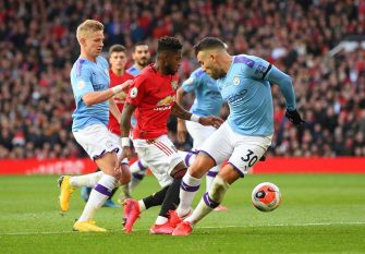 MANCHESTER, ENGLAND - MARCH 08: Nicolas Otamendi of Manchester City challenges Fred of Manchester United in the penalty box before Fred is booked for simulation during the Premier League match between Manchester United and Manchester City at Old Trafford on March 08, 2020 in Manchester, United Kingdom. (Photo by Michael Regan/Getty Images)