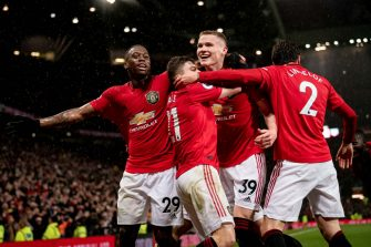 MANCHESTER, ENGLAND - MARCH 08: Scott McTominay of Manchester United celebrates scoring their second goal during the Premier League match between Manchester United and Manchester City at Old Trafford on March 08, 2020 in Manchester, United Kingdom. (Photo by Ashley Donelon/Manchester United via Getty Images)