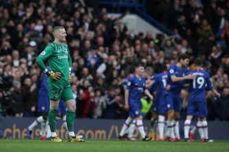 LONDON, ENGLAND - MARCH 08: Jordan Pickford of Everton looks dejected after Olivier Giroud of Chelsea scores a goal to make it 4-0 during the Premier League match between Chelsea FC and Everton FC at Stamford Bridge on March 08, 2020 in London, United Kingdom. (Photo by Robin Jones/Getty Images)