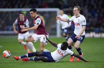 BURNLEY, ENGLAND - MARCH 07: Burnley player Jack Cork is challenged by Davinson Sanchez of Spurs during the Premier League match between Burnley FC and Tottenham Hotspur at Turf Moor on March 07, 2020 in Burnley, United Kingdom. (Photo by Stu Forster/Getty Images)
