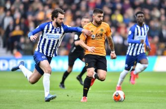 WOLVERHAMPTON, ENGLAND - MARCH 07: Ruben Neves of Wolverhampton Wanderers is challenged by Davy Propper of Brighton and Hove Albion during the Premier League match between Wolverhampton Wanderers and Brighton & Hove Albion at Molineux on March 07, 2020 in Wolverhampton, United Kingdom. (Photo by Nathan Stirk/Getty Images)
