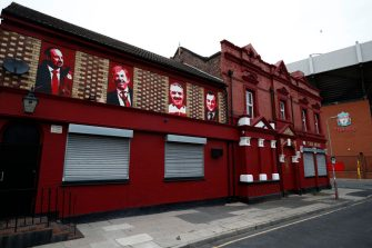LIVERPOOL, UNITED KINGDOM - MAY 10: A deserted Anfield stadium, the home of Liverpool Football Club, photographed on what would have been the weekend of their last home game of the 2019-20 Premier League season against Chelsea, on May 10, 2020 in Liverpool, United Kingdom. All Premier League matches have been postponed since March 13th due to the coronavirus pandemic, leaving Liverpool with a 25-point lead at the top of the Premiership. The country continued quarantine measures intended to curb the spread of Covid-19, but the infection rate is falling, and government officials are discussing the terms under which it would ease the lockdown. (Photo by Clive Brunskill/Getty Images)