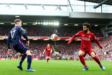 LIVERPOOL, ENGLAND - MARCH 07: Mohamed Salah of Liverpool and Jack Stacey of Bournemouth during the Premier League match between Liverpool FC and AFC Bournemouth  at Anfield on March 7, 2020 in Liverpool, United Kingdom. (Photo by Robbie Jay Barratt - AMA/Getty Images)