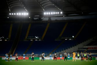 Players hold a minute of silence for coronavirus victims prior to the TIM Italian Cup (Coppa Italia) final football match Napoli vs Juventus on June 17, 2020 at the Olympic stadium in Rome, played behind closed doors as the country gradually eases the lockdown aimed at curbing the spread of the COVID-19 infection, caused by the novel coronavirus. (Photo by Filippo MONTEFORTE / AFP) (Photo by FILIPPO MONTEFORTE/AFP via Getty Images)