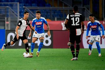 Juventus' Portuguese forward Cristiano Ronaldo (L) challenges Napoli's Italian defender Giovanni Di Lorenzo (2ndL) during the TIM Italian Cup (Coppa Italia) final football match Napoli vs Juventus on June 17, 2020 at the Olympic stadium in Rome, played behind closed doors as the country gradually eases the lockdown aimed at curbing the spread of the COVID-19 infection, caused by the novel coronavirus. (Photo by Filippo MONTEFORTE / AFP) (Photo by FILIPPO MONTEFORTE/AFP via Getty Images)