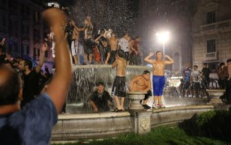 Napoli's supporters celebrate on a public fountain in downtown Naples after Napoli won the TIM Italian Cup (Coppa Italia) final football match Napoli vs Juventus on June 17, 2020, played at the Olympic stadium in Rome behind closed doors as the country gradually eases the lockdown aimed at curbing the spread of the COVID-19 infection, caused by the novel coronavirus. (Photo by Carlo Hermann / AFP) (Photo by CARLO HERMANN/AFP via Getty Images)