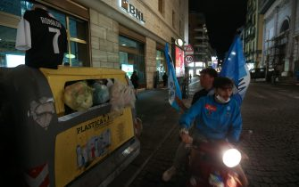 Napoli's supporters ride a scooter past a public trash on which stands a dress form with a Ronaldo jersey, as supporters celebrate in downtown Naples after Napoli won the TIM Italian Cup (Coppa Italia) final football match Napoli vs Juventus on June 17, 2020, played at the Olympic stadium in Rome behind closed doors as the country gradually eases the lockdown aimed at curbing the spread of the COVID-19 infection, caused by the novel coronavirus. (Photo by Carlo Hermann / AFP) (Photo by CARLO HERMANN/AFP via Getty Images)