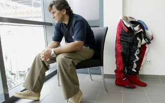LAUSITZ, GERMANY - MAY 11: Ex-Formula 1 and CART racing driver Alex Zanardi of Italy relaxes before he prepares to drive in his specially adapted Cart for his disability caused by a crash in Germany in 2001, next to Alex is his race suit with the prosthetic legs built into them, at the Euro Speedway in Lausitz May 11, 2003 in Germany. (Photo by Mark Thompson/Getty Images)