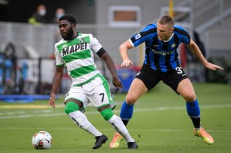 MILAN, ITALY - JUNE 24: (L-R) Jeremie Boga of Sassuolo, Milan Skriniar of Internazionale  during the Italian Serie A   match between Internazionale v Sassuolo at the San Siro on June 24, 2020 in Milan Italy (Photo by Mattia Ozbot/Soccrates/Getty Images)