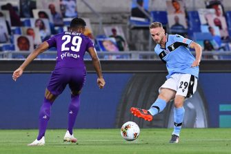 Lazio's Italian midfielder Manuel Lazzari (R) challenges Fiorentina's Brazilian defender Dalbert during the Italian Serie A football match Lazio vs Fiorentina played on June 27, 2020 behind closed doors at the Olympic stadium in Rome, as the country eases its lockdown aimed at curbing the spread of the COVID-19 infection, caused by the novel coronavirus. (Photo by Alberto PIZZOLI / AFP) (Photo by ALBERTO PIZZOLI/AFP via Getty Images)