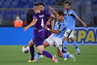 Lazio's Italian forward Ciro Immobile (R) challenges Fiorentina's Serbian defender Nikola Milenkovic during the Italian Serie A football match Lazio vs Fiorentina played on June 27, 2020 behind closed doors at the Olympic stadium in Rome, as the country eases its lockdown aimed at curbing the spread of the COVID-19 infection, caused by the novel coronavirus. (Photo by Alberto PIZZOLI / AFP) (Photo by ALBERTO PIZZOLI/AFP via Getty Images)