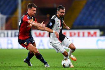 GENOA, ITALY - JUNE 30: Andrea Pinamonti of Genoa (left) and Miralem Pjanic of Juventus vie for the ball during the Serie A match between Genoa CFC and Juventus FC at Stadio Luigi Ferraris on June 30, 2020 in Genoa, Italy. (Photo by Paolo Rattini/Getty Images)