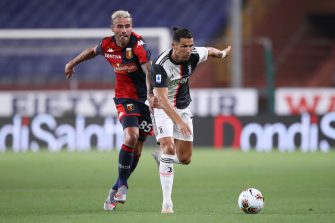 GENOA, ITALY - JUNE 30: Juventus's Portuguese striker Cristiano Ronaldo (R) takes on Genoa's Swiss midfielder Valon Behrami during the Serie A match between Genoa CFC and  Juventus at Stadio Luigi Ferraris on June 30, 2020 in Genoa, Italy. (Photo by Jonathan Moscrop/Getty Images)