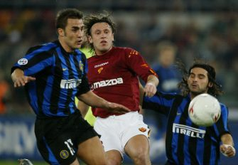 ROME, ITALY:  AS Roma forward Antonio Cassano (C) challenges Inter Milan's Fabio Cannavaro (L) and Daniele Adani in a  Serie A match at Rome Olympic stadium 07 March 2004.    (Photo credit should read PAOLO COCCO/AFP via Getty Images)