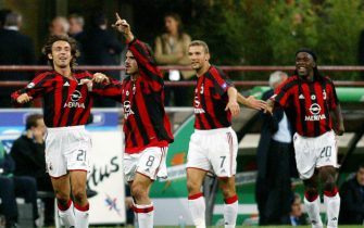 Milan AC's (fromL) Andrea Pirlo, Gennaro Gattuso, Andry Shevchenko and Clarence Seedorf celebrate after teammate Filippo Inzaghi scored the first goal against Inter Milan during their Italian Serie A match 05 October 2003 at San Siro stadium in Milan.  AFP PHOTO / PATRICK HERTZOG  (Photo credit should read PATRICK HERTZOG/AFP via Getty Images)