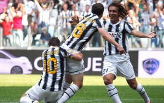 Juventus' Swiss player Stephan Lichtsteiner (C) is congratulated by teammates Alessandro Del Piero (L) and Andrea Pirlo after he scored a goal against Parma during their serie A football match at the Delle Alpi stadium in Turin on September 11, 2011.  AFP PHOTO / FABIO MUZZI (Photo credit should read FABIO MUZZI/AFP via Getty Images)
