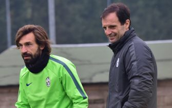 Juventus' midfielder Andrea Pirlo and Juventus' coach Massimiliano Allegri (R) attend a training session on the eve of their Champions League football match Juventus vs Malmoe on November 25, 2014 at the Juventus training centre in Vinovo near Turin. AFP PHOTO / GIUSEPPE CACACE        (Photo credit should read GIUSEPPE CACACE/AFP via Getty Images)