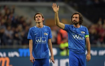 MILAN, ITALY - MAY 21:  Nicolo and Andrea Pirlo greets leaving the field at the end during Andrea Pirlo Farewell Match at Stadio Giuseppe Meazza on May 21, 2018 in Milan, Italy.  (Photo by Pier Marco Tacca/Getty Images)