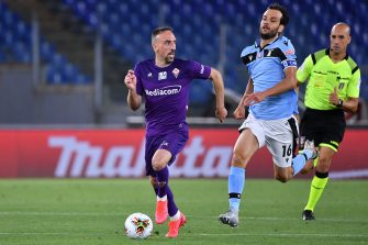 Fiorentina's French forward Franck Ribery outruns Lazio's Italian midfielder Marco Parolo during the Italian Serie A football match Lazio vs Fiorentina played on June 27, 2020 behind closed doors at the Olympic stadium in Rome, as the country eases its lockdown aimed at curbing the spread of the COVID-19 infection, caused by the novel coronavirus. (Photo by Alberto PIZZOLI / AFP) (Photo by ALBERTO PIZZOLI/AFP via Getty Images)