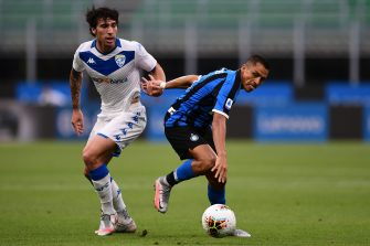 Inter Milan's Chilean forward Alexis Sanchez (R) holds off Brescia's Italian midfielder Sandro Tonali during the Italian Serie A football match Inter vs Brescia played behind closed doors on July 1, 2020 at the Giuseppe-Meazza San Siro stadium in Milan, as the country eases its lockdown aimed at curbing the spread of the COVID-19 infection, caused by the novel coronavirus. (Photo by Miguel MEDINA / AFP) (Photo by MIGUEL MEDINA/AFP via Getty Images)