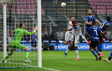 Inter Milan's Italian defender Danilo D'Ambrosio (Top R) scores a header during the Italian Serie A football match Inter vs Brescia played behind closed doors on July 1, 2020 at the Giuseppe-Meazza San Siro stadium in Milan, as the country eases its lockdown aimed at curbing the spread of the COVID-19 infection, caused by the novel coronavirus. (Photo by Miguel MEDINA / AFP) (Photo by MIGUEL MEDINA/AFP via Getty Images)