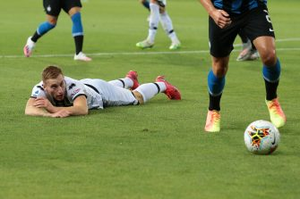 PARMA, ITALY - JUNE 28: Parma Calcio's Swedish midfielder Dejan Kulusevski lays on the pitch looking on in dismay after going down under challenge from Inter's Italian midfielder Nicolo Barella and Uruguayan defender Diego Godin  during the Serie A match between Parma Calcio and  FC Internazionale at Stadio Ennio Tardini on June 28, 2020 in Parma, Italy. (Photo by Jonathan Moscrop/Getty Images)