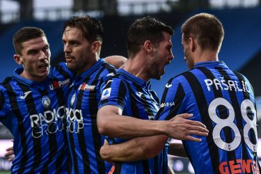 (From L) Atalanta's German defender Robin Gosens, Atalanta's Brazilian defender Rafael Toloi, Atalanta's Swiss midfielder Remo Freuler and Atalanta's Croatian midfielder Mario Pasalic celebrate after Pasalic opened the scoring during the Italian Serie A football match Atalanta vs Napoli played on July 2, 2020 behind closed doors at the Atleti Azzurri d'Italia stadium in Bergamo, as the country eases its lockdown aimed at curbing the spread of the COVID-19 infection, caused by the novel coronavirus. (Photo by Miguel MEDINA / AFP) (Photo by MIGUEL MEDINA/AFP via Getty Images)