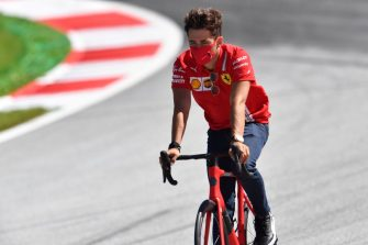 TOPSHOT - Ferrari's Monegasque driver Charles Leclerc inspects the track on his bicycle on July 2, 2020, on the eve of the first practice session at the Austrian Formula One Grand Prix in Spielberg, Austria. - Seven months after they last competed in earnest, the Formula One circus will push a post-lockdown re-set button to open the 2020 season in Austria on July 5. (Photo by JOE KLAMAR / AFP) (Photo by JOE KLAMAR/AFP via Getty Images)