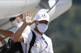 Mercedes' Finnish driver Valtteri Bottas waves as he arrives to airport Hinterstoisser in Zeltweg, Austria on July 2, 2020, on the eve of the first practice session at the Austrian Formula One Grand Prix in Spielberg, Austria. - Seven months after they last competed in earnest, the Formula One circus will push a post-lockdown re-set button to open the 2020 season in Austria on July 5. (Photo by ERWIN SCHERIAU / APA / AFP) / Austria OUT (Photo by ERWIN SCHERIAU/APA/AFP via Getty Images)