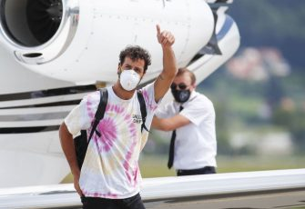 Renault's Australian driver Daniel Ricciardo wears a face mask as he leaves the aircraft upon his arrival to the military airport Hinterstoisser in Zeltweg, Austria on July 2, 2020, on the eve of the first practice session at the Austrian Formula One Grand Prix in Spielberg, Austria. - Seven months after they last competed in earnest, the Formula One circus will push a post-lockdown re-set button to open the 2020 season in Austria on July 5. (Photo by ERWIN SCHERIAU / APA / AFP) / Austria OUT (Photo by ERWIN SCHERIAU/APA/AFP via Getty Images)