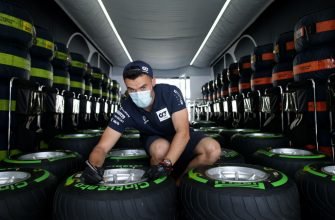 SPIELBERG, AUSTRIA - JULY 02:  Scuderia AlphaTauri team member works on tyres in the garage during previews for the F1 Grand Prix of Austria at Red Bull Ring on July 02, 2020 in Spielberg, Austria. (Photo by Peter Fox/Getty Images)