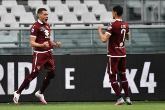 TURIN, ITALY - JUNE 30: Andrea Belotti of Torino FC celebrates after scoring the opening goal with teammate Sasa Lukic during the Serie A match between Torino FC and  SS Lazio at Stadio Olimpico di Torino on June 30, 2020 in Turin, Italy. (Photo by Stefano Guidi/Getty Images)