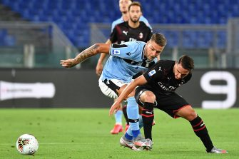 Lazio's Serbian midfielder Sergej Milinkovic-Savic (C) and AC Milan's Algerian defender Ismael Bennacer (R) go for the ball during the Italian Serie A football match Lazio vs AC Milan played behind closed doors on July 4, 2020 at the Olympic stadium in Rome, as the country eases its lockdown aimed at curbing the spread of the COVID-19 infection, caused by the novel coronavirus. (Photo by Tiziana FABI / AFP) (Photo by TIZIANA FABI/AFP via Getty Images)