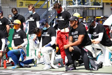 SPIELBERG, AUSTRIA - JULY 05: Lewis Hamilton of Great Britain and Mercedes GP, Pierre Gasly of France and Scuderia AlphaTauri  and some of the F1 drivers take a knee on the grid in support of the Black Lives Matter movement ahead of the Formula One Grand Prix of Austria at Red Bull Ring on July 05, 2020 in Spielberg, Austria. (Photo by Mark Thompson/Getty Images)