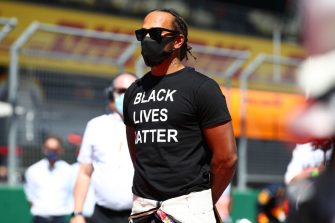 SPIELBERG, AUSTRIA - JULY 05: Lewis Hamilton of Great Britain and Mercedes GP is seen on the grid wearing a black lives matter t-shirt ahead of the Formula One Grand Prix of Austria at Red Bull Ring on July 05, 2020 in Spielberg, Austria. (Photo by Mark Thompson/Getty Images)