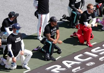 SPIELBERG, AUSTRIA - JULY 05: Lewis Hamilton of Great Britain and Mercedes GP, Pierre Gasly of France and Scuderia AlphaTauri  and Sebastian Vettel of Germany and Ferrari take a knee on the grid in support of the Black Lives Matter movement ahead of the Formula One Grand Prix of Austria at Red Bull Ring on July 05, 2020 in Spielberg, Austria. (Photo by Peter Fox/Getty Images)