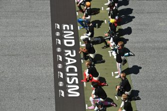 SPIELBERG, AUSTRIA - JULY 05: Some of the F1 drivers take a knee on the grid in support of the Black Lives Matter movement ahead of the Formula One Grand Prix of Austria at Red Bull Ring on July 05, 2020 in Spielberg, Austria. (Photo by Joe Klamar/Pool via Getty Images)