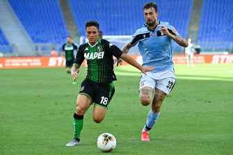 Sassuolo's Italian forward Giacomo Raspadori (L) outruns Lazio's Italian defender Francesco Acerbi during the Italian Serie A football match Lazio Rome vs Sassuolo played behind closed doors on July 11, 2020 at the Olympic stadium in Rome, as the country eases its lockdown aimed at curbing the spread of the COVID-19 infection, caused by the novel coronavirus. (Photo by Vincenzo PINTO / AFP) (Photo by VINCENZO PINTO/AFP via Getty Images)