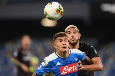 NAPLES, ITALY - JULY 12: Giovanni Di Lorenzo of SSC Napoli vies with Theo Hernandez of  AC Milan during the Serie A match between SSC Napoli and  AC Milan at Stadio San Paolo on July 12, 2020 in Naples, Italy. (Photo by Francesco Pecoraro/Getty Images)