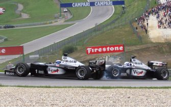 Finnish Mercedes-McLaren driver Mika Hakkinen (L) looses control of his car after beeing hit by teammate Scottish David Coulthard on the racetrack during the Austrian Formula One Grand Prix, in Spielberg 25 July 1999.   (ELECTRONIC IMAGE) (Photo by PIERRE VERDY / AFP) (Photo by PIERRE VERDY/AFP via Getty Images)