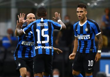 MILAN, ITALY - JULY 13:  Ashley Young (C) of FC Internazionale celebrates his goal with his team-mates Borja Valero (L) and Lautaro Martinez (R) during the Serie A match between FC Internazionale and Torino FC at Stadio Giuseppe Meazza on July 13, 2020 in Milan, Italy.  (Photo by Marco Luzzani/Getty Images)