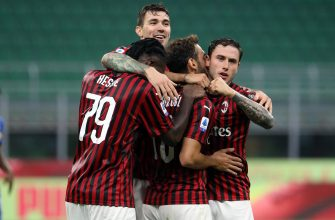 AC MilanÕs Hakan Calhanoglu jubilates with his teammates after scoring goal of 3 to 1  during the Italian serie A soccer match  Ac Milan vs Parma  at Giuseppe Meazza stadium in Milan 15 July  2020.