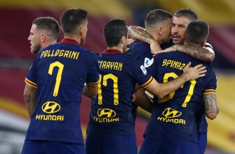 ROME, ITALY - JULY 15: (BILD ZEITUNG OUT) Edin Dzeko of AS Roma and Aleksandar Kolarov of AS Roma celebrates after scoring his team's second goal with team mates during the Serie A match between AS Roma and Hellas Verona at Stadio Olimpico on July 15, 2020 in Rome, Italy. (Photo by Matteo Ciambelli/DeFodi Images via Getty Images)