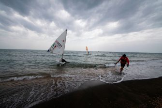 A woman goes sailing the Tyrrhenian Sea on a beach in Ostia, west of Rome, on May 18, 2020 as the country's lockdown is easing after over two months, aimed at curbing the spread of the COVID-19 infection, caused by the novel coronavirus. - Restaurants and churches reopen in Italy on May 18, 2020 as part of a fresh wave of lockdown easing in Europe and the country's latest step in a cautious, gradual return to normality, allowing businesses and churches to reopen after a two-month lockdown. (Photo by Tiziana FABI / AFP) (Photo by TIZIANA FABI/AFP via Getty Images)
