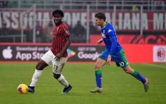, ITALY - DECEMBER 15: (L-R) Franck Kessie of AC Milan, Filip Djuricic of Sassuolo during the Italian Serie A   match between AC Milan v Sassuolo on December 15, 2019 (Photo by Mattia Ozbot/Soccrates/Getty Images)