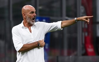 AC Milan's Italian coach Stefano Pioli  gestures during the Italian Serie A football match AC Milan vs Bologna played behind closed doors on July 15, 2020 at the San Siro Stadium in Milan, as the country eases its lockdown aimed at curbing the spread of the COVID-19 infection, caused by the novel coronavirus. (Photo by MARCO BERTORELLO / AFP) (Photo by MARCO BERTORELLO/AFP via Getty Images)