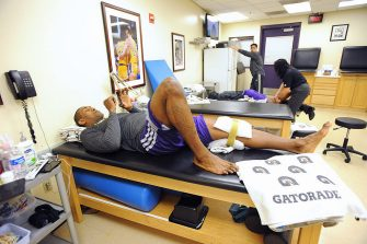 LOS ANGELES, CA - APRIL 12: Metta World Peace #15 of the Los Angeles Lakers ices his knee in the training room before playing against the Golden State Warriors at Staples Center on April 12, 2013 in Los Angeles, California. NOTE TO USER: User expressly acknowledges and agrees that, by downloading and/or using this Photograph, user is consenting to the terms and conditions of the Getty Images License Agreement. Mandatory Copyright Notice: Copyright 2013 NBAE (Photo by Andrew D. Bernstein/NBAE via Getty Images)
