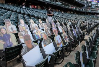 epa08565100 Cutouts of fans are placed in seats before the start of the MLB baseball game between the Minnesota Twins and the Chicago White Sox at Guaranteed Rate Field in Chicago, Illinois, USA, 24 July 2020. Major League Baseball has started an abbreviated 2020 season playing in ballparks without fans.  EPA/TANNEN MAURY