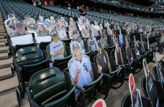 epa08565101 Cutout images of fans sit in seats before the start of the MLB baseball game between the Minnesota Twins and the Chicago White Sox at Guaranteed Rate Field in Chicago, Illinois, USA, 24 July 2020. Major League Baseball has started an abbreviated 2020 season playing in ballparks without fans.  EPA/TANNEN MAURY